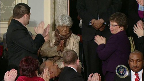 With help from a centenarian, Obama calls for voting reforms