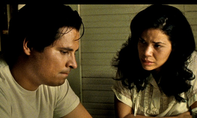 Michael Pena as Chavez with his wife, Helen (America Ferrera)