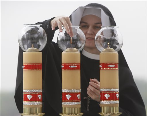 Poles Applaud Beloved John Paul II's Sainthood