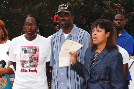 Vanessa White, from left, and Victor White, Sr. listen as attorney Carol Powell-Lexing speaks during a news conference in New Iberia, La., Aug. 27, about the shooting of Victor White III. Authorities say 22-year-old Victor White III died on March 2 in the back seat of an Iberia Parish Sheriff's Offi ce car, with his hands bound behind his back. State police say the fi ndings of an investigation into the death of White III are leading detectives to conclude he was not shot by police. (Courtesy of The Final Call)