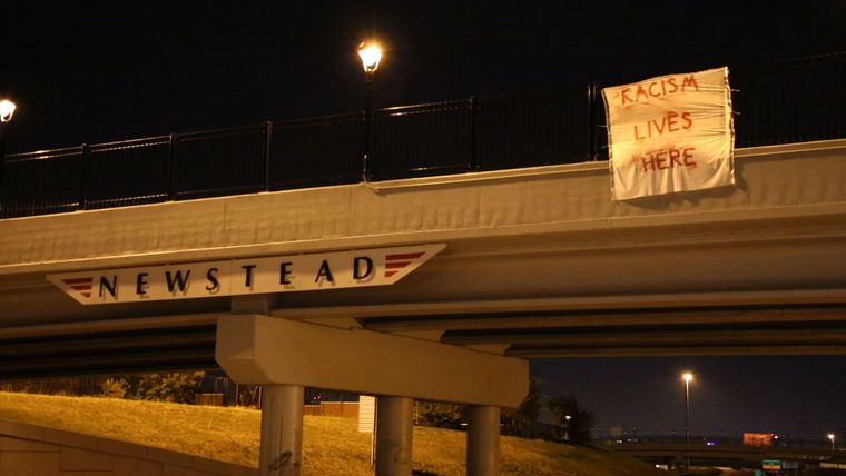 Protestors Hang More Than 40 Banners on Highway Overpasses