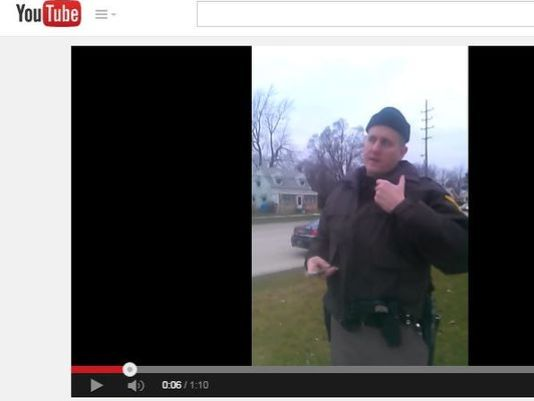 Man, Cop Film Stop for Walking with Hands in Pockets