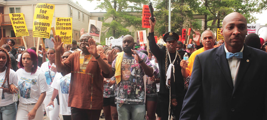 'Hands Up! Don't Shoot!' Activist Says Ferguson Struggle Far from Over