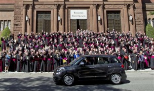 Pope Francis leaves St. Mathews Cathedral in his Fiat 500 after a midday prayer service in Washington, Wednesday, Sept. 23, 2015, as bishops applaud. (AP Photo/Jose Luis Magana)