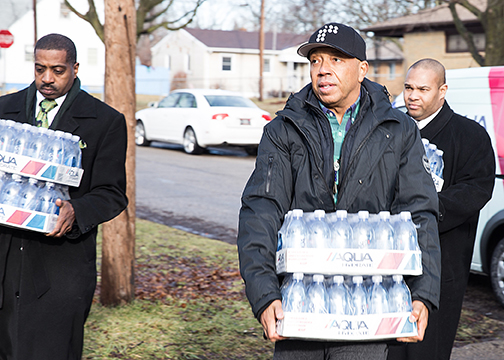Russell Simmons Brings Water and Attention to Plight of Flint Residents