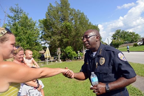 Cecil Smith, the new police chief in Sanford, Fla., greeting residents during a community outreach initiative. (Courtesy of Sarah Beth Glicksteen for The New York Times)