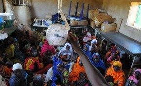 Women watch as their children are being weighed at MSF's Ambulant Therapeutic Feeding Center in Chad.