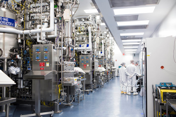 Amgen is preparing three sites, including a 75-acre plant in Rhode Island, to make a cholesterol drug if production is approved.