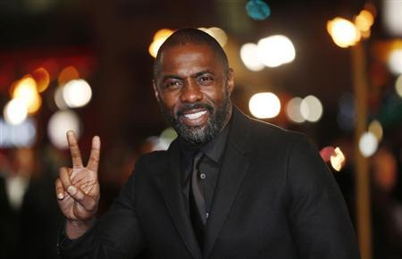 """Actor Idris Elba gestures as he arrives for the world premiere of """"Les Miserables"""" in London December 5, 2012. REUTERS/Suzanne Plunkett"""