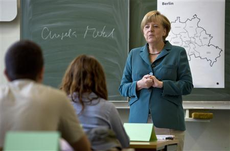 German Chancellor Merkel conducts a lecture at Heinrich Schliemann Gymnasium in Berlin
