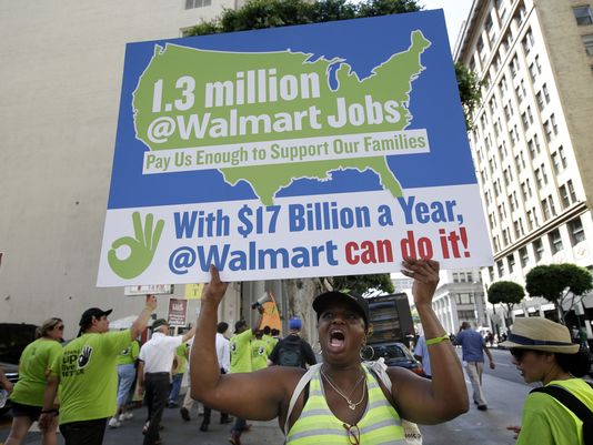 A women chants slogans at a protest against Walmart in September in Los Angeles. Walmart workers and supporters took part in a nationwide day of protests calling for better jobs and higher wages.