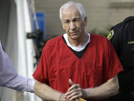 Former Penn State University assistant football coach Jerry Sandusky is taken from the Centre County Courthouse after being sentenced to at least 30 years in prison in the child sexual abuse scandal that brought shame to Penn State. (Photo: Matt Rourke, AP)