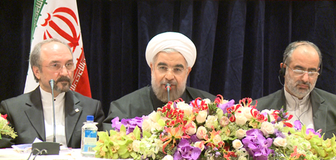 Iranian President Hassan Rouhani, center, speaks from head table. (Courtesy of the Final Call)