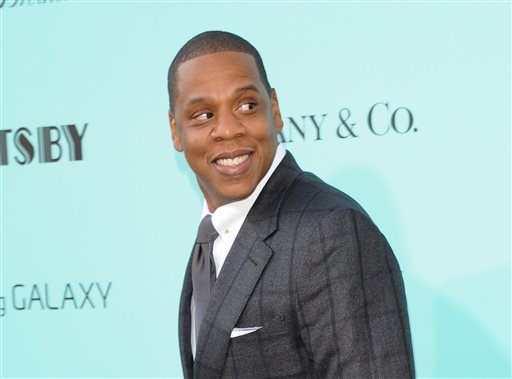 "In this May 1, 2013 file photo, Jay-Z arrives at ""The Great Gatsby"" world premiere in New York City's  Avery Fisher Hall. In a statement posted on his website on Friday, Nov. 15, 2013, the entertainer said that he's planning to move forward with his scheduled collaboration with Barneys New York despite allegations that black shoppers had been racially profiled at the high-end retailer.  The posting went on to state that he agreed to the launch of his BNY SCC collection under the condition he could serve on a newly-created council convened by the store to deal with racial profiling. (Photo by Evan Agostini/Invision/AP, File)"