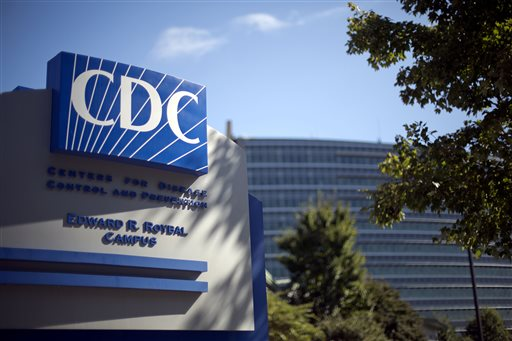 In this Tuesday, Oct. 8, 2013, file photo, a sign marks the entrance to the federal Centers for Disease Control and Prevention,in Atlanta. The agency released its first progress report Thursday, and CDC officials said they're mostly pleased.  (AP Photo/David Goldman, File)