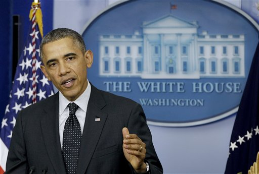 President Barack Obama gestures while speaking in the James Brady Press Briefing Room of the White House in Washington, Thursday, Nov. 21, 2013. (AP Photo/Carolyn Kaster)
