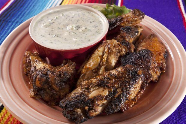 Americans will devour 1.25 billion chicken wings on Super Bowl Sunday -- that's four wings for every man, woman and child. (Cathy Miller/Inside Jersey)
