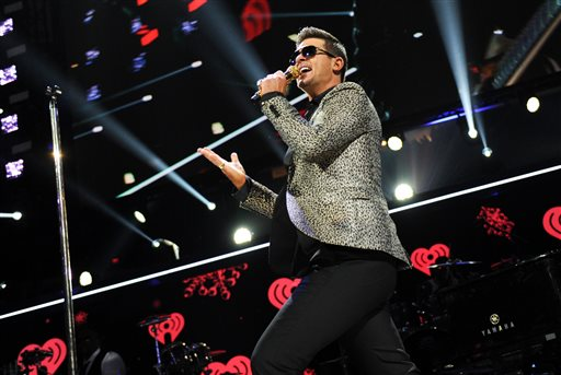 "This Dec. 13, 2013 file photo shows Robin Thicke performing at Z100's Jingle Ball 2013 at Madison Square Garden in New York. Marvin Gaye's children have dismissed their lawsuit against EMI after claiming the record label didn't pursue copyright infringement against Robin Thicke because ""Blurred Lines"" has similarities to Gaye's ""Got to Give It Up."" A Los Angeles judge Tuesday, Jan. 14, 2014, granted Nona Marvisa Gaye and Frankie Christian Gaye's dismissal against EMI, which is owned by Sony/ATV Music Publishing.  (Photo by Evan Agostini/Invision/AP, File)"