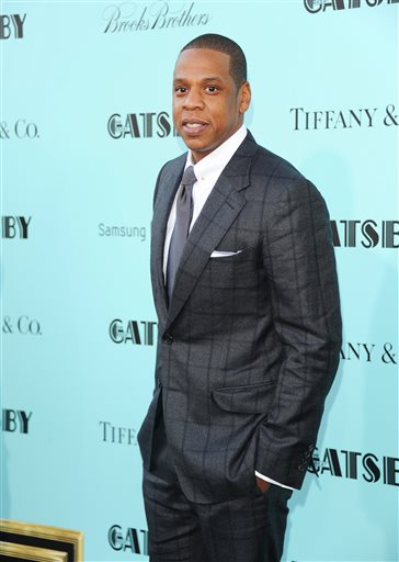 "In this May 1, 2013 file photo, Jay-Z attends ""The Great Gatsby"" world premiere at Avery Fisher Hall in New York. Beyonce and Jay Z share the top spot on Billboard's Power 100 list announced on Thursday, Jan. 23, 2014.  (Photo by Evan Agostini/Invision/AP, File)"
