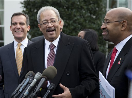 Rep. Chaka Fattah, D-Pa., center, flanked by Los Angeles Mayor Eric Garcetti, left, and Philadelphia Mayor Michael Nutter, right, speaks outside the White House in Washington, Thursday, Jan. 9, 2014, after an event hosted by President Barack Obama about the Promise Zones Initiative. The Promise Zone Initiative is part of a plan to create a better bargain for the middle-class by partnering with local communities and businesses to create jobs, increase economic security, expand educational opportunities, increase access to quality, affordable housing and improve public safety. (AP Photo/Carolyn Kaster)