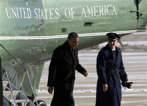 President Barack Obama, escorted by Colonel William M. Knight, Commander of the 11th Wing, walks toward Air Force One from the Marine One helicopter, upon arrival at Andrews Air Force Base, Md., Thursday, Jan. 30, 2014, en route to Waukesha, Wis., to speak about job training. ( AP Photo/Jose Luis Magana)