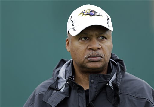 Baltimore Ravens offensive coordinator Jim Caldwell walks onto the field as his team warms up during an NFL Super Bowl XLVII football practice in New Orleans. (AP Photo/Patrick Semansky, File)
