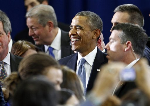 President Barack Obama greets supporters after speaking at McGavock High School on Thursday, Jan. 30, 2014, in Nashville, Tenn. Also pictured is former Vice President Al Gore, behind. (AP Photo/Wade Payne)