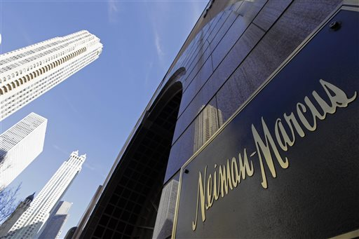In this Wednesday, March 11, 2009 file photo, the Chicago skyline is reflected in the exterior of Neiman Marcus on Michigan Avenue in Chicago. (AP Photo/M. Spencer Green, File)