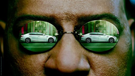 "This undated frame grab provided by Kia shows the company's 2014 Super Bowl commercial. The third-quarter ad to introduce its K900 luxury sedan, features Laurence Fishburne reprising his ""Matrix"" role as Morpheus and displays some surprising operatic skills. (AP Photo/Kia)"