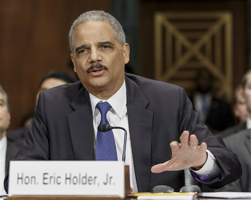 In this Jan. 29, 2014 file photo, Attorney General Eric Holder testifies on Capitol Hill in Washington. Holder called on a group of states Tuesday to restore voting rights to ex-felons, part of a push to fix what he sees as flaws in the criminal justice system that have a disparate impact on racial minorities.  (AP Photo/J. Scott Applewhite, File)