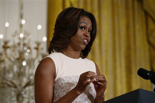 """First lady Michelle Obama recites a """"wrap"""" song written by students from George C. Marshall High School in Falls Church, Va., about healthy eating  as she announced proposed guidelines for local school wellness policies during an event in the East Room at the White House in Washington, Tuesday, Feb. 25, 2014. (AP Photo/Charles Dharapak)"""