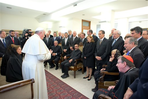 In this picture provided by the Vatican newspaper L'Osservatore Romano, Pope Francis meets with an Argentine interreligious group, at the Vatican, Thursday, Feb. 27, 2014. According to Vatican Radio, the group, made up of 15 jews, 15 muslims and 15 catholics, had just returned from a pilgrimage to Jordan, Israel and Palestine, where Pope Francis is scheduled to travel in May. (AP Photo/L'Osservatore Romano, ho)