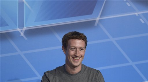 Mark Zuckerberg Chairman and CEO of Facebook pauses, during a conference at the Mobile World Congress, the world's largest mobile phone trade show in Barcelona, Spain, Monday, Feb. 24, 2014. (AP Photo/Manu Fernandez)