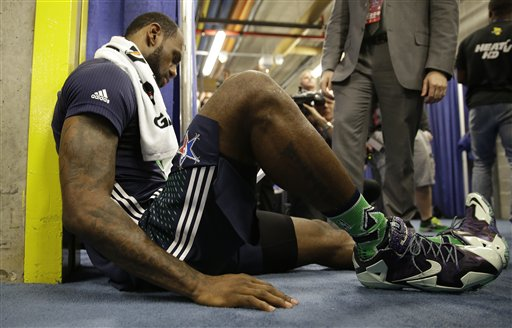 The Miami Heat's LeBron James looks at the end of game stats after the NBA All Star basketball game, Sunday, Feb. 16, 2014, in New Orleans.  (AP Photo/Gerald Herbert)