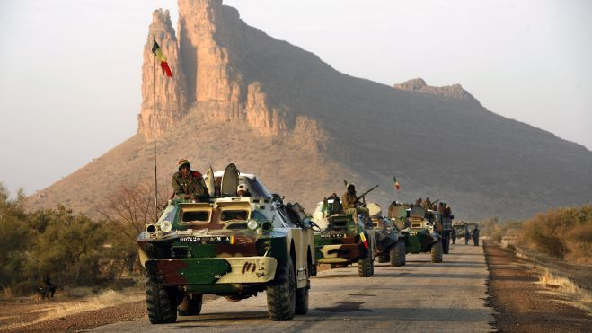 Feb. 4, 2013 - A convoy of Malian troops makes a stop to test some of their weapons near Hambori, northern Mali, on the road to Gao. (AP)