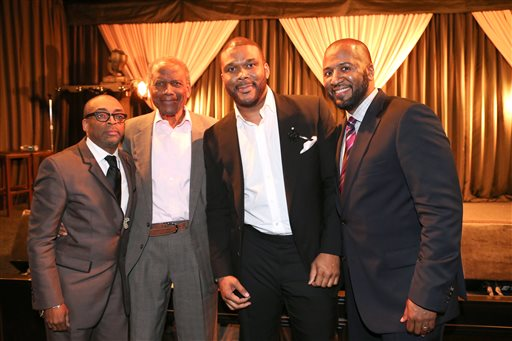 This Feb. 26, 2014 photo released by shows, from left, Spike Lee, Sidney Poitier, Tyler Perry and Malcolm Lee at a ceremony by Essence magazine honoring the achievements of African-American men in Hollywood, in Beverly Hills, Calif. (AP Photo/Essence-Tyler Perry, George Burns)