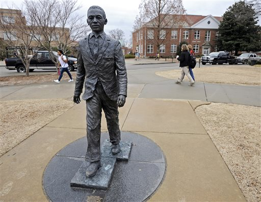 The James Meredith statue is seen on the University of Mississippi campus in Oxford, Miss., Monday, Feb. 17, 2014. A $25,000 reward is available for information leading to the arrest of two men involved in sullying the statue early Sunday, Feb. 16. (AP Photo/The Daily Mississippian, Thomas Graning)
