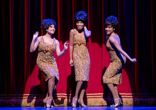 """This theater image released by Boneau/Bryan-Brown shows, from left, Sydney Morton as Forence Ballard, Valisia LeKae as Diana Ross and Ariana DeBose as Mary Wilson of The Supremes in """"Motown: The Musical,"""" performing at the Lunt-Fontanne Theatre in New York. Producers of """"Motown the Musical"""" said Thursday, Feb. 6, 2014, that the show's national tour will play Detroit''s Fisher Theatre for four-weeks between Oct. 21-Nov. 16. (AP Photo/Boneau/Bryan-Brown, Joan Marcus)"""