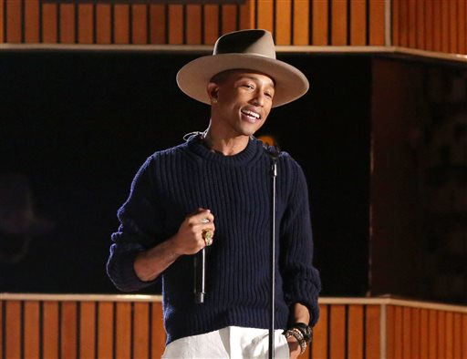 This Jan. 26, 2014 file photo shows Pharrell Williams on stage at the 56th annual Grammy Awards at Staples Center in Los Angeles. (Photo by Matt Sayles/Invision/AP, File)
