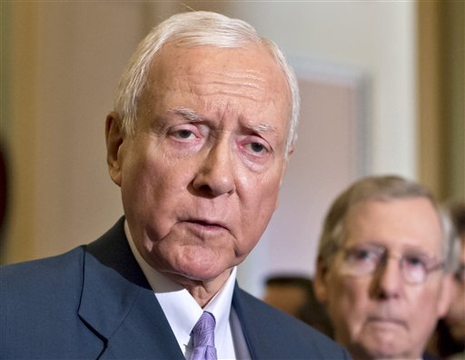 In this July 30, 2013 file photo, Sen. Orrin Hatch, R-Utah, left, accompanied by Senate Minority Leader Mitch McConnell of Ky. speaks with reporters on Capitol Hill in Washington. (AP Photo/J. Scott Applewhite, File)