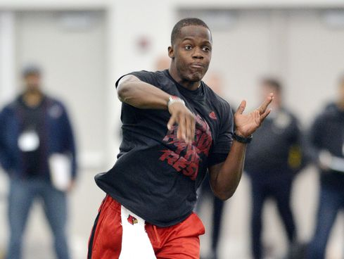 Louisville quarterback Teddy Bridgewater participates in a passing drill during his pro day at the University of Louisville in Louisville on Monday, March 17, 2014. (Timothy D. Easley/AP)