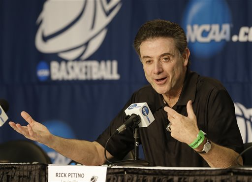 Louisville head coach Rick Pitino answers questions at a news conference for the NCAA college basketball tournament in Orlando, Fla., Wednesday, March 19, 2014.  Manhattan plays against Louisville in a second round game on Thursday. (AP Photo/John Raoux)