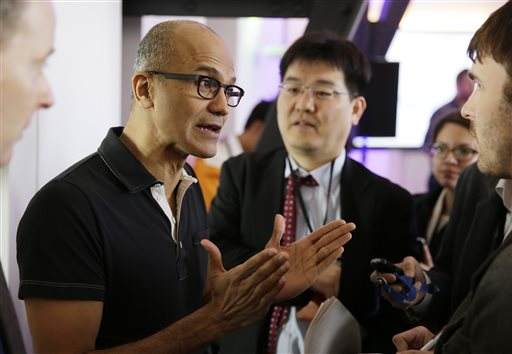 Microsoft CEO Satya Nadella gestures while speaking with reporters after giving a press briefing on the intersection of cloud and mobile computing Thursday, March 27, 2014, in San Francisco. (AP Photo/Eric Risberg)