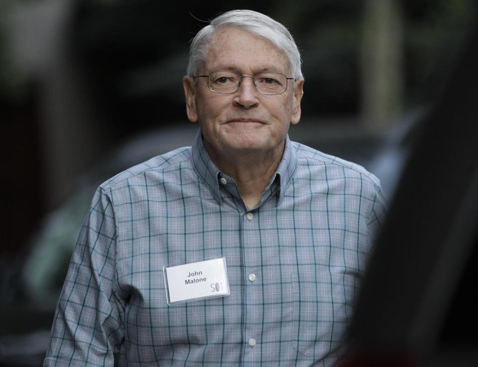 In this Wednesday, July 11, 2012, file photo, John Malone. chairman of Liberty Media and CEO of Discovery Holding Company. arrives at the Allen & Company Sun Valley Conference in Sun Valley, Idaho. Liberty Global Inc., the cable TV operator controlled by Malone, announced Wednesday, Feb. 6, 2013, it s buying U.K.-based Virgin Media Inc. in a $16 billion deal that steps up the rivalry between Malone and fellow billionaire Rupert Murdoch. (AP Photo/Paul Sakuma, File)