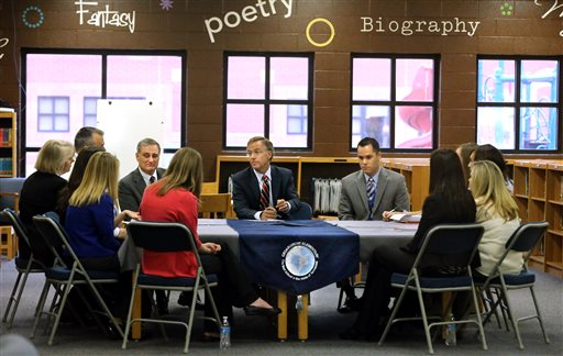 Tennessee Gov. Bill Haslam, center, speaks with with Rutherford County teachers, principals, and school officials at Cedar Grove Elementary School in Smyrna, Tenn., Tuesday, March 18, 2014, to discuss Common Core State Standards. The Governor visited  three schools, one in each Tennessee Region, east, middle, and west to discuss Common Core.  Rutherford County School Superintendent, Don Odom, left of  Haslam and Cedar Grove Elementary Principal mark Gullion listen to the discussion. (AP Photo/Daily News Journal, Helen Comer)