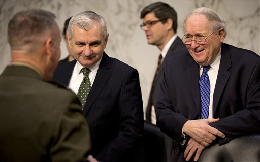 Senate Armed Services Committee Chairman Sen. Carl Levin, D-Mich., right, and Sen. Jack Reed, D-R.I., center, talk with Marine Gen. Joseph F. Dunford, Jr., left, Commander, International Security Assistance Force, on Capitol Hill in Washington, Wednesday, March 12, 2014, before the committee's hearing on the situation in Afghanistan. (AP Photo/Carolyn Kaster)