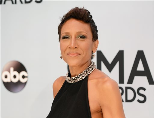 "This Nov. 6, 2013 file photo shows Robin Roberts at the 47th annual CMA Awards at Bridgestone Arena in Nashville, Tenn. Roberts will appear as a guest judge on ABC's ""Dancing With the Stars."" (Photo by Evan Agostini/Invision/AP, File)"
