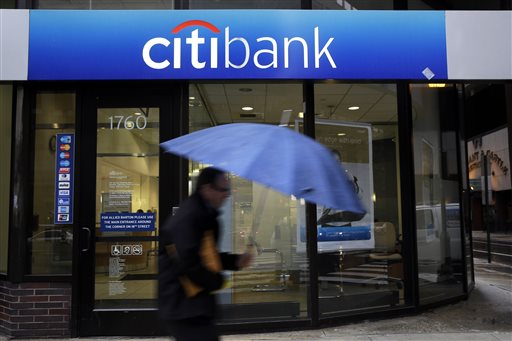 In this Jan. 14, 2014 file photo, a person walks past a Citibank location in Philadelphia. (AP Photo/Matt Rourke, File)
