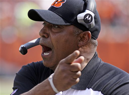 In this Sept. 25, 2011, file photo, Cincinnati Bengals head coach Marvin Lewis urges on his players during the first half of an NFL football game against the San Francisco 49ers in Cincinnati. Lewis signed a one-year contract extension Friday, March 14, 2014, keeping him on the job through the 2015 season. (AP Photo/Tom Uhlman, File)