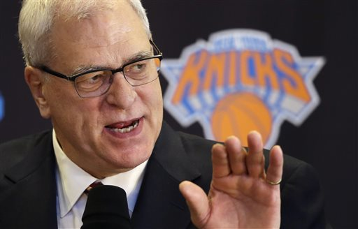 In this March 18, 2014 file photo, Phil Jackson, the new president of the New York Knicks, answers questions during a news conference in New York. Jackson won't be hiring himself to coach the Knicks. (AP Photo/Mark Lennihan, File)